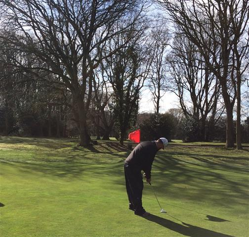 Putting on the 6th green in winter