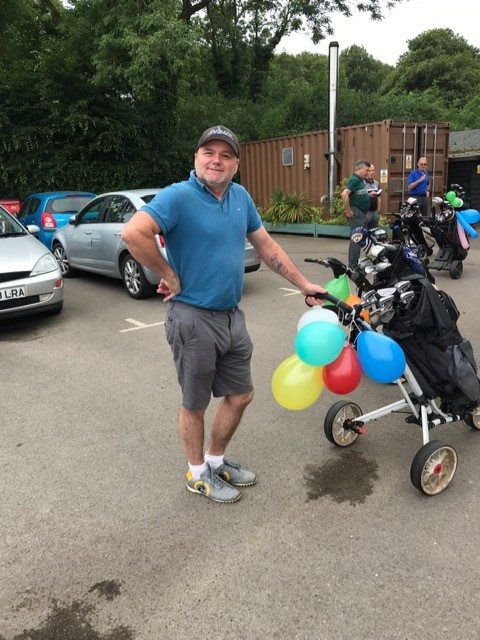Simon Devine with a fully compliment of balloons prior to his Captain's Day round. The balloons are popped after each 'Mulligan' is taken. A Mulligen is a free retake of your last shot!