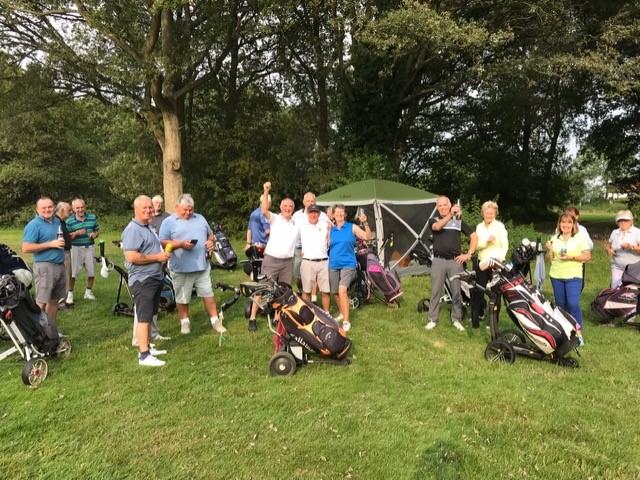 Golfers enjoying the free drinks at the halfway house